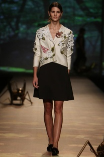 Ivory floral applique jacket with black skirt