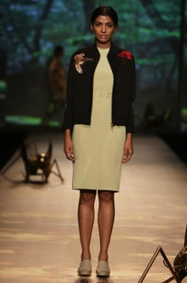 Black applique jacket with pale green dress