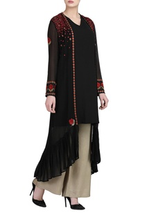black-embroidered-jacket-with-slip-beige-trousers