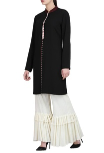 black-embroidered-tunic-ivory-ruffle-pants
