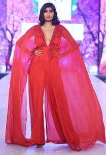 red-jumpsuit-with-dramatic-cape-sleeves