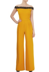mustard-off-shoulder-jumpsuit-with-an-embellished-neckline