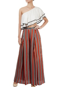 white-one-shoulder-top-striped-trousers