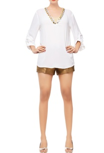 white-top-with-triangle-embellishments
