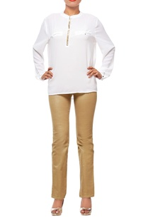 white-blouse-with-embellished-button-stand