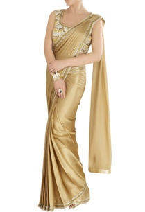 gold-sari-with-an-embroidered-blouse