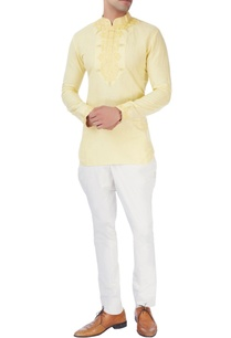 yellow-short-kurta-with-white-trousers