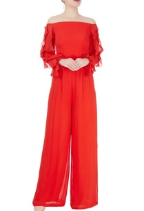 red-jumpsuit-with-ruffled-sleeves