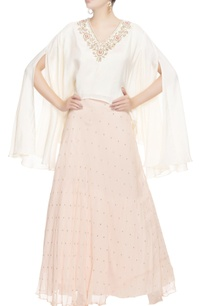 white-blouse-with-peach-sequin-skirt