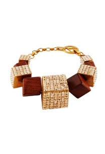 gold-bracelet-with-wood-metal-motifs