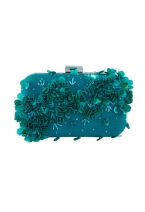 blue-clutch-with-three-dimensional-motifs