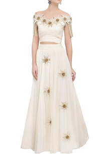 ivory-off-shoulder-tassel-blouse-lehenga