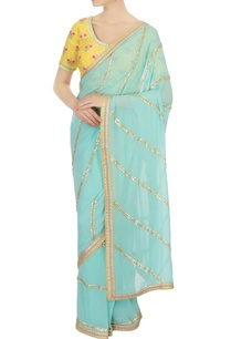 turquoise-blue-sari-with-yellow-blouse-petticoat