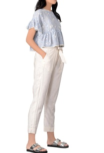 blue-ruffle-blouse-white-pants