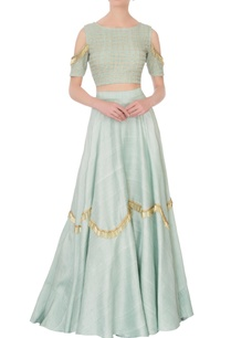 green-cold-shoulder-blouse-with-raw-silk-lehenga