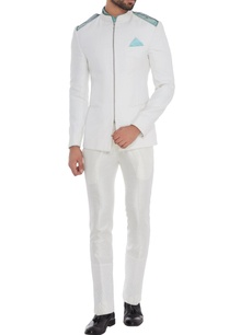 white-cold-shoulder-chino-jacket-with-blue-shirt-white-trousers