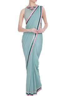 dusty-blue-georgette-sequin-border-saree-with-rose-embroidered-blouse