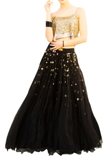black-net-layered-flared-lehenga-with-gold-sequin-blouse