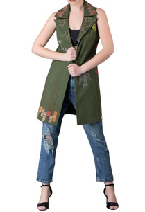 green-sleeveless-jacket