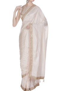 embroidered-sleeveless-blouse-with-lace-border-saree