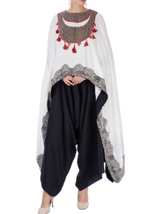 white-embroidered-cape-with-black-pants