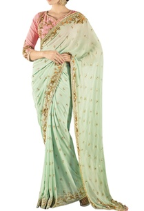 mint-green-embroidered-sari-with-a-peach-blouse