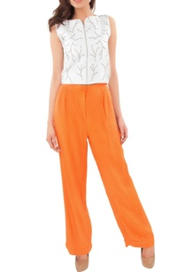 white-beadwork-crop-top-with-orange-trousers