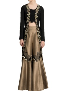 black-jacket-crop-top-with-flared-gold-pants