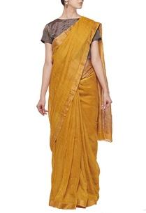 mustard-linen-sari-with-gold-border