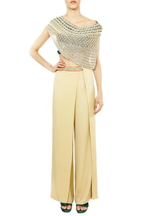 off-shoulder-embellished-blouse-with-beige-trousers