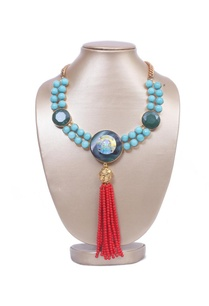 turquoise-stones-with-red-tassels-necklace