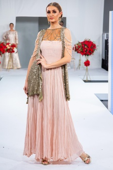 Gown with attached sequin embroidered cape