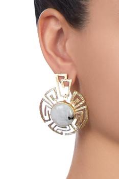 Grey circular shaped earrings