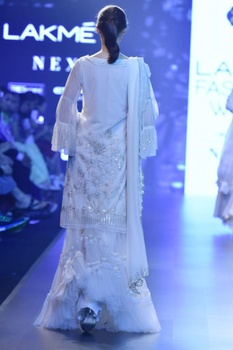 Ivory net kurta with tiered ghararas & sequin dupatta
