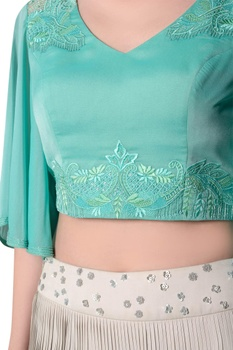 Blue embroidered blouse with flowy sleeves