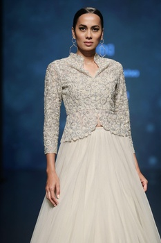 Pale beige hand embroidered jacket with pouf lehenga