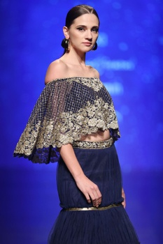 Midnight blue tiered style dupion silk lehenga with bustier & cape