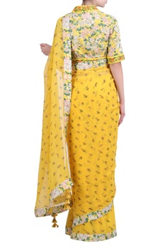 Yellow chiffon printed saree with embroidered & jaal printed blouse