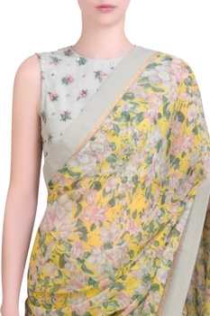 Yellow chiffon printed saree with embroidered blouse