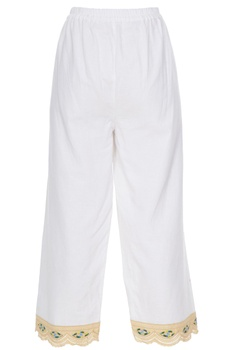 White elastic waistband pants with 'evil eye' embroidered panel
