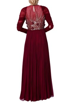 Embroidered dress with flared pleated style