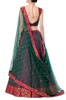 Sleeveless blouse with brocade embroidered lehenga and dupatta