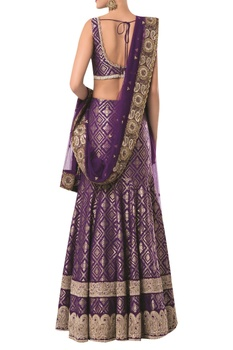 Sleeveless blouse with brocade embroidered lehenga and dupatta