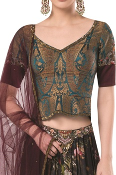 Frilly layered lehenga with brocade blouse and net dupatta