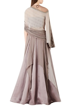 Cape style blouse with asymmetric lehenga