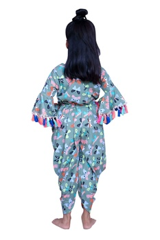 Printed jumpsuit with pompom sleeves.