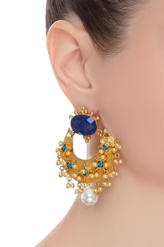 Statement earrings encrusted with stones