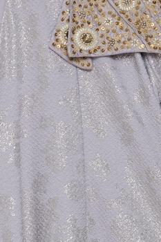 Emboridered asymmetric dress with tassels