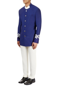 Blue bandhgala with ivory pants