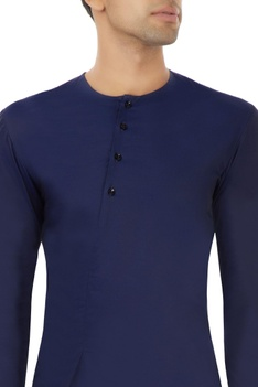 Navy blue shirt with an off centre opening